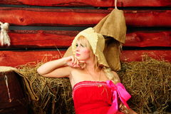 Blond in the hayloft Royalty Free Stock Photo