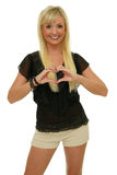 Blond heart symbol. Blond woman showing heart symbol with her hands, smiling stock image