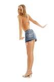 Blond heureux dans la jupe de denim Images stock