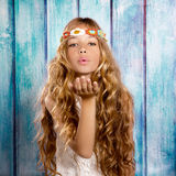 Blond hippie children girl blowing mouth with hand royalty free stock photo