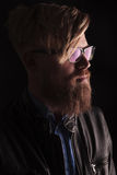 Blond hipster man wearing glasses. Close up portrait of a blond hipster man wearing glasses and a leather jacket Royalty Free Stock Photo