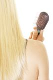 Blond holding brush Royalty Free Stock Image
