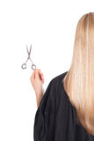 A blond holding scissors and a comb. Isolated on white backgroun Stock Images