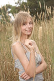 Blond holding straw Royalty Free Stock Image