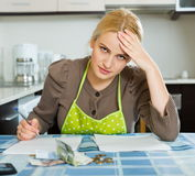 Blond housewife filling payments bills Royalty Free Stock Photos