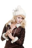 Blond ice woman wearing a fur hat with snowflake Royalty Free Stock Image