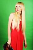 Blond im roten Kleid Stockfotografie