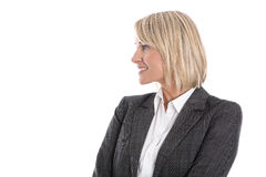 Blond isolated mature business woman looking sideways to text. Stock Image