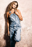 Blond in jeans Royalty Free Stock Photography