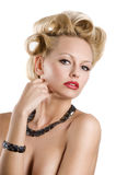 The blond with jewellery Stock Images