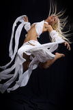 Blond jumping Stock Images