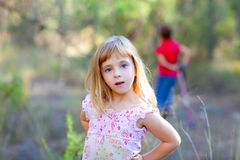 Blond kid girl in forest park Royalty Free Stock Photography