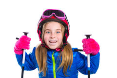 Blond kid girl happy going to snow with ski poles and helmet Royalty Free Stock Photos