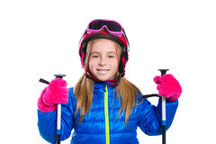 Blond kid girl happy going to snow with ski poles and helmet Stock Photos