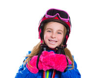 Blond kid girl happy going to snow with ski poles and helmet Royalty Free Stock Images