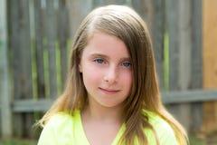 Blond kid girl happy portrait outdoor Stock Images