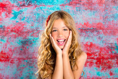 Blond kid girl happy smiling expression hands in face. Gesture royalty free stock photos