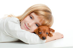 Blond kid girl with mini pinscher pet mascot dog. On white background royalty free stock photo