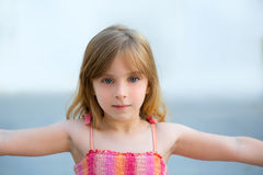 Blond kid girl open arms in outdoor Stock Photos