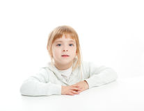 Blond kid girl portrait on white desk table Stock Photos