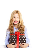 Blond kid girl with present gift red ribbon box Royalty Free Stock Photos