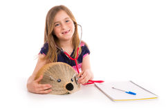 Blond kid girl pretending be doctor with hedgehog Royalty Free Stock Photo