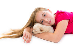 Blond kid girl with puppy chihuahua pet dog Stock Image