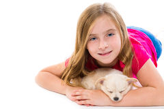 Blond kid girl with puppy chihuahua pet dog Royalty Free Stock Images