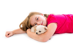 Blond kid girl with puppy chihuahua pet dog Stock Photo
