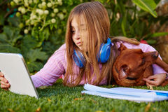 Blond kid girl selfie photo tablet pc and dog Royalty Free Stock Photo