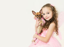 Blond kid girl with small pet dog. Blondy kid girl in fairy dress  with small pet dog Stock Photo