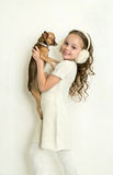 Blond kid girl with small pet dog Royalty Free Stock Image