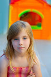 Blond kid girl smiling in outdoor playground Royalty Free Stock Image