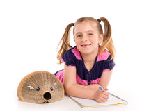 Blond kid girl student with hedgehog book Royalty Free Stock Image