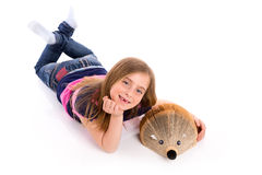Blond kid girl student with hedgehog book Stock Photos