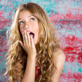 Blond kid girl surprised expression hands in face Royalty Free Stock Photography