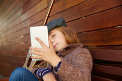 Blond kid girl taking selfie guitar and winter beret Stock Photos