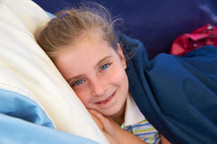 Blond kid girl tired relaxed smiling indented Royalty Free Stock Photos