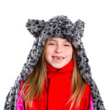 Blond kid girl with winter gray feline fur scarf hat in white. Background royalty free stock photo