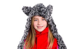 Blond kid girl with winter gray feline fur scarf hat in white Royalty Free Stock Photo