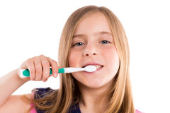Blond kid indented girl cleaning teeth toothbrush Stock Photos