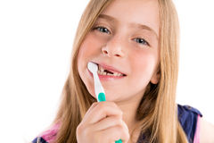 Blond kid indented girl cleaning teeth toothbrush Royalty Free Stock Photo