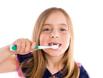 Blond kid indented girl cleaning teeth toothbrush Royalty Free Stock Image