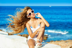 Blond kid teen girl on the beach long curly hair. Blond kid teen girl on the beach long with curly hair waving at wind Stock Photography