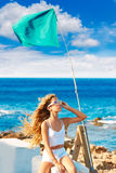 Blond kid teen girl on the beach long curly wind hair Stock Photography