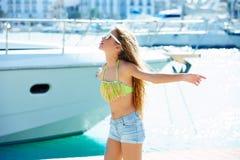 Blond kid teen girl in Mediterranean port Spain Royalty Free Stock Photography