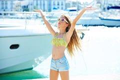 Blond kid teen girl in Mediterranean port Spain Royalty Free Stock Images