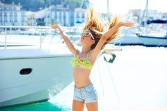 Blond kid teen girl in Mediterranean port Spain Stock Photos