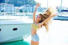 Blond kid teen girl in Mediterranean port Spain Royalty Free Stock Photos