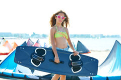 Blond kite surf teen girl in summer beach Royalty Free Stock Photos